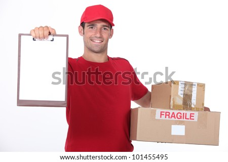 young man delivering parcels - stock photo