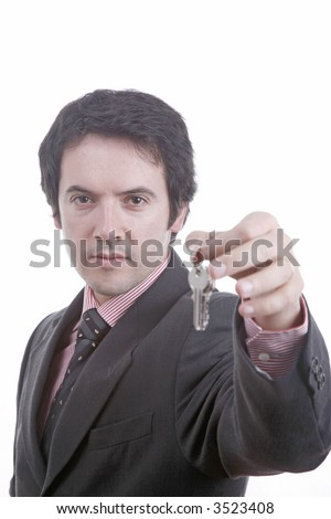 young man delivers the keys... - stock photo