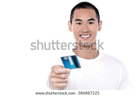 Young man displaying his debit card to camera