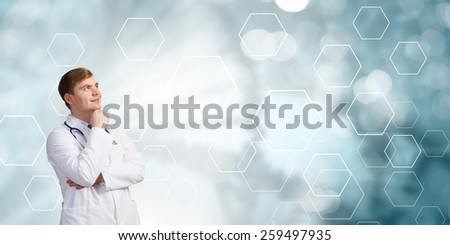 Young man doctor seriously thinking something over - stock photo