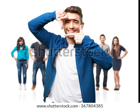 young man doing a frame gesture - stock photo