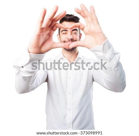young man doing a heart symbol - stock photo