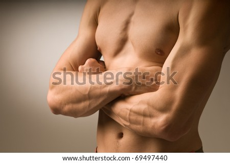 Young man doing his exercise - stock photo