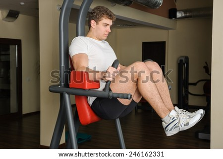 young man doing lats pull-down workout - stock photo