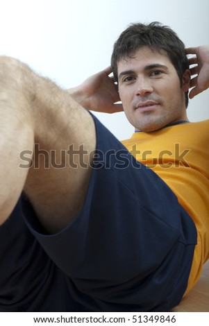 Young man doing sit-ups