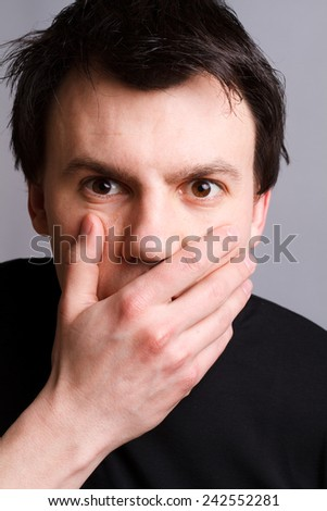 Young man doing surprise gesture - stock photo