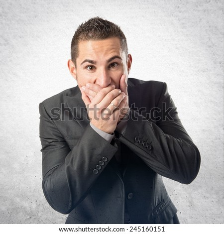 Young man doing surprise gesture over textured background - stock photo