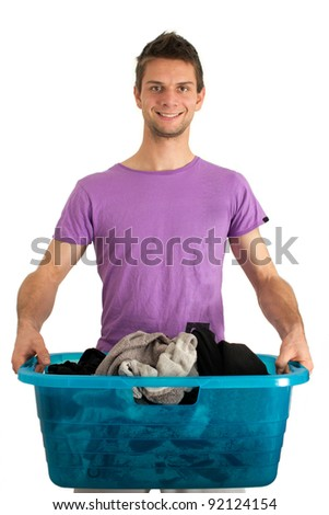 Young man doing the washing - stock photo