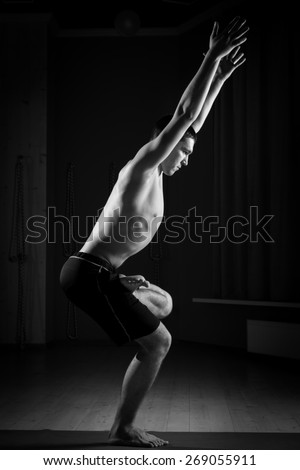 young man doing yoga , black and white - stock photo