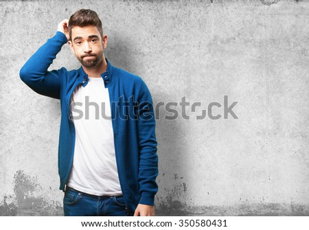 young man doubting - stock photo