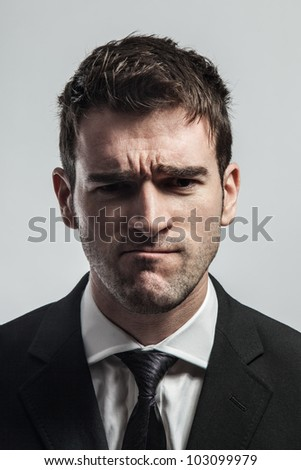Young man doubts about something. - stock photo