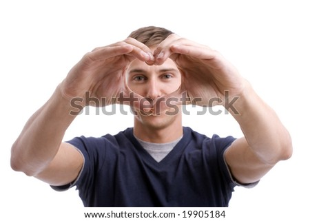 Young Man Drawing Heart with Hands - focus on hands - stock photo