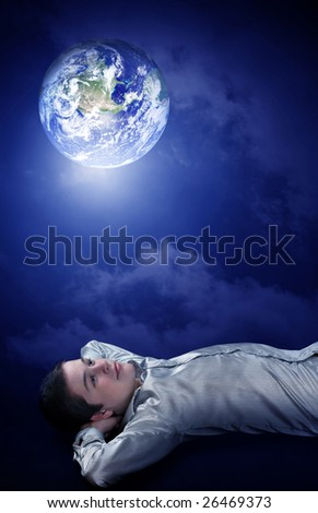 Young man dreaming to his future on earth - stock photo