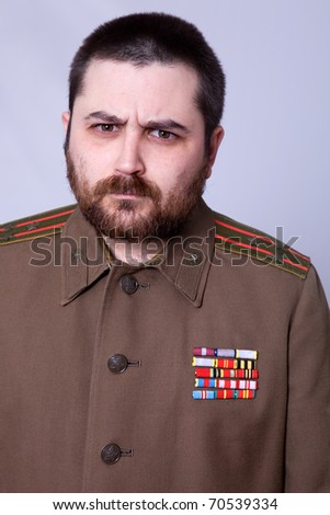young man dressed as russian military, studio