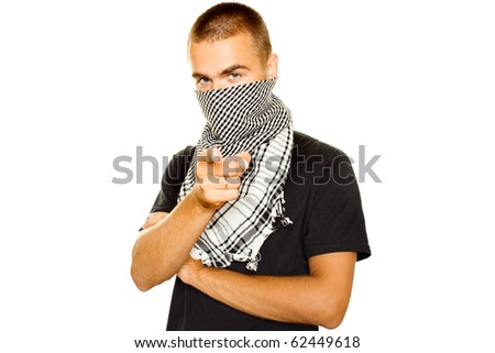 Young man dressed in black t-shirt on the face of a Palestinian scarf. Finger points in the frame. Stubble on his face. Lots of copyspace and room for text on this isolate - stock photo