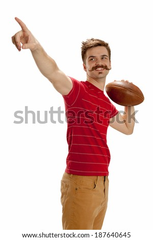Young man dressed in casual street clothes holds a football, ready to throw a pass, isolated on white background - stock photo