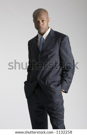 Young man dressed sharply - stock photo