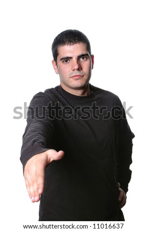 young man dressed with casual clothes giving handshake - stock photo