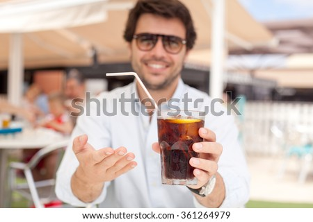 Young man drinking a beverage - stock photo