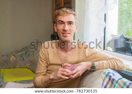 Young man drinking berry smoothie