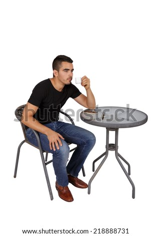 young man drinking coffee at a table on a white background