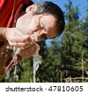 Young man drinking cold fresh water - stock photo