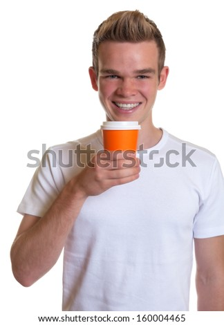 Young man drinking hot coffee   - stock photo