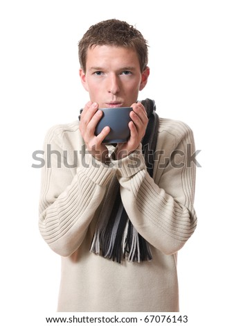 young man drinking warm beverage in bowl isolated over white background - stock photo