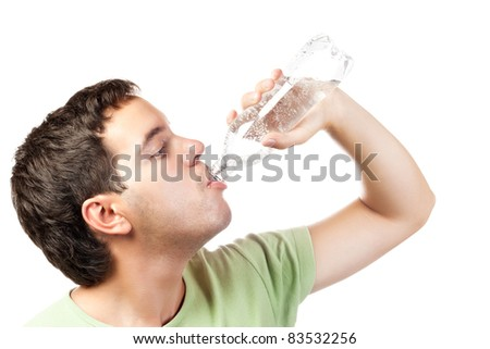 young man drinking water from bottle isolated on white background - stock photo