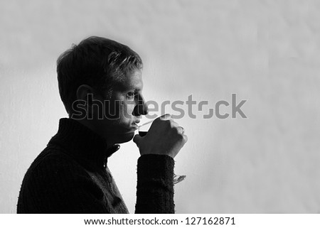 young man drinking wine, black and white