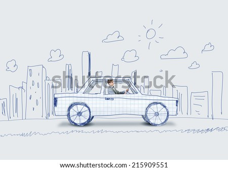 Young man driving car made of sheet of paper - stock photo