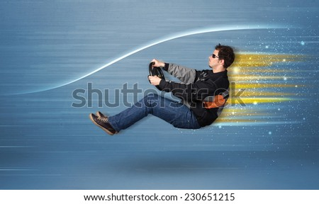 Young man driving in imaginary fast car with blurred lines concept - stock photo