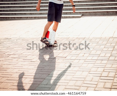 Young man driving on Solowheel in the park