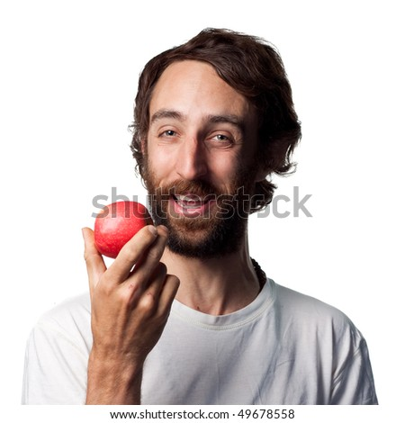 Young man eating a fresh apple - stock photo