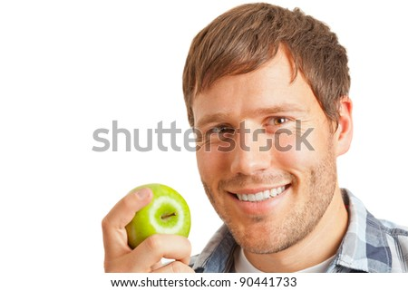 Young man eating an apple - healthy diet concept - stock photo