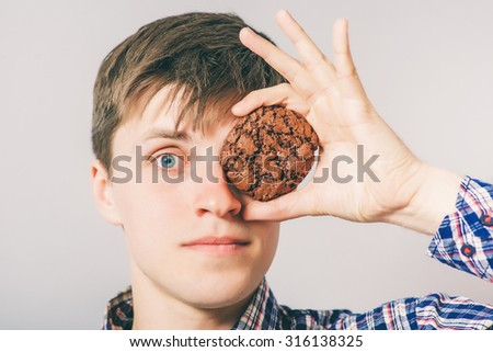young man eating cookies or biscuits