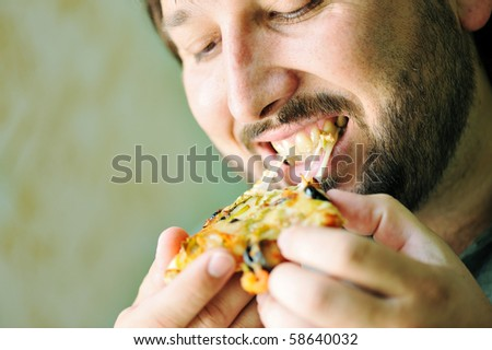 Young Man Eating Pizza - stock photo