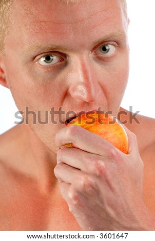 young  man eats  red apple on  white background