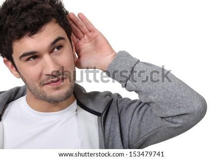 young man eavesdropping - stock photo