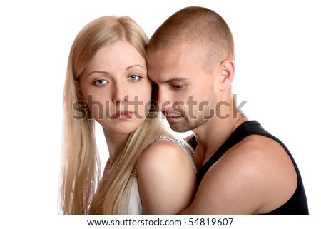 young man embraces the girl on a white background
