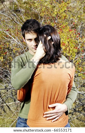 Young man embracing her woman - stock photo