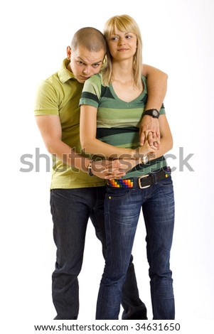 young man embracing his girlfriend over white background
