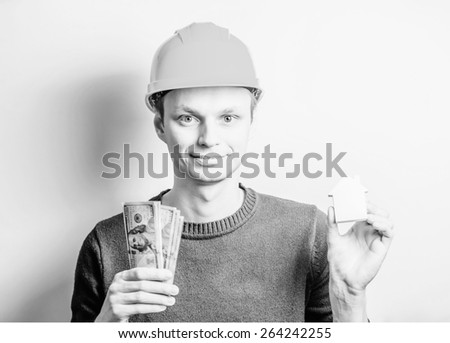 young man engineer money - stock photo