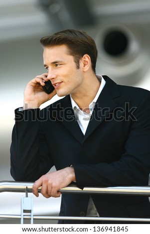 young man enjoying a conversation over the cellphone - stock photo