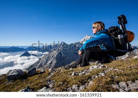 Young man enjoying mountain scenery - stock photo