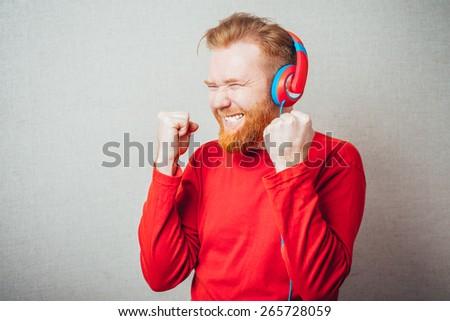 young man enjoying music - stock photo
