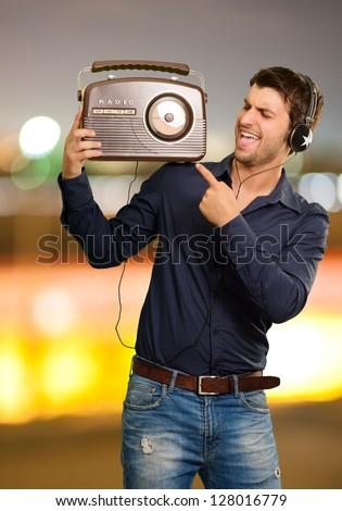 Young Man Enjoying Music, Outdoors - stock photo
