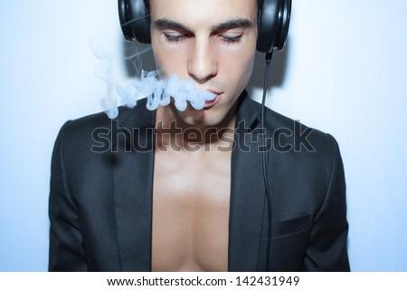 Young man enjoying the music - stock photo