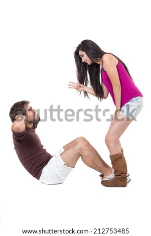 Young man excercising with beautiful demanding personal trainer doing situps isolated on white - stock photo
