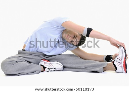 young man exercise fitness sport and strech isolated on white in studio - stock photo